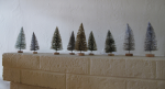 The little parade of trees on the mantel.